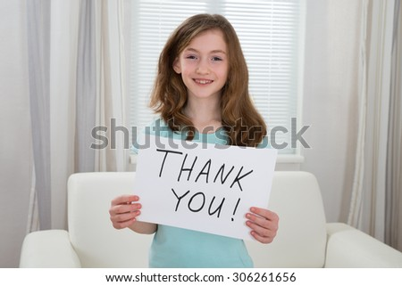 Happy Girl Holding Board With The Text Thank You At Home - stock photo