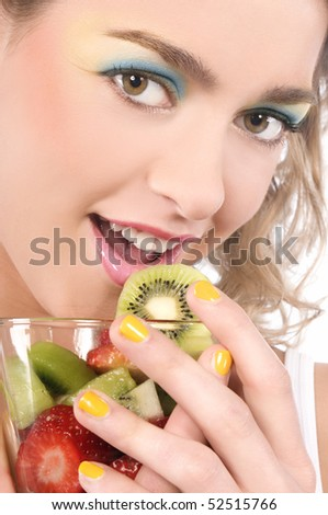 Happy girl holding fruit-dessert - stock photo