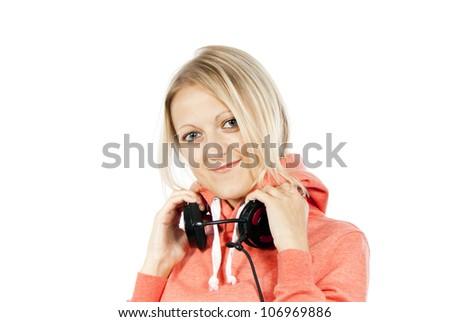 happy girl holding headphones isolated - stock photo