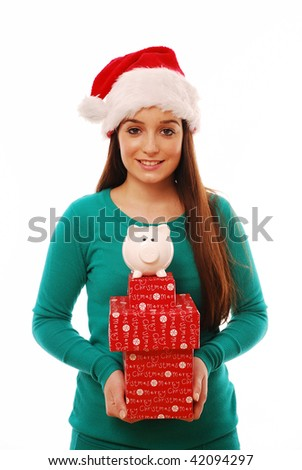 Happy girl holding piggy bank and presents - stock photo
