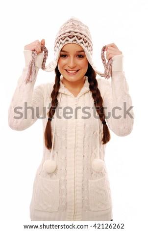 Happy girl holding up plaits on hat - stock photo