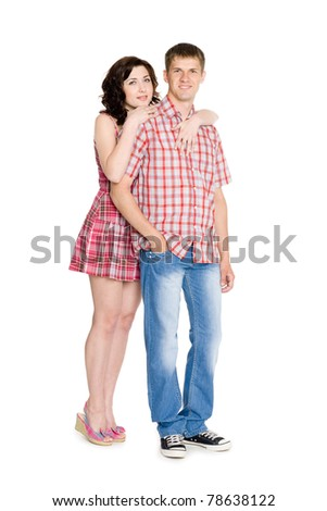 Happy girl hugging a guy. Isolated on white. - stock photo