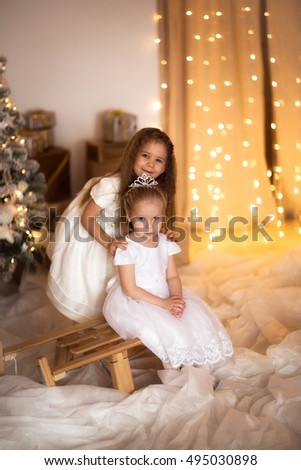 Happy Girl Hugging Near The Christmas Tree And Gifts Concept Merry