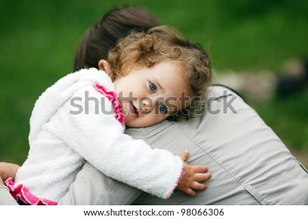 happy girl hugs mother - stock photo