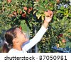happy girl in apple garden. - stock photo