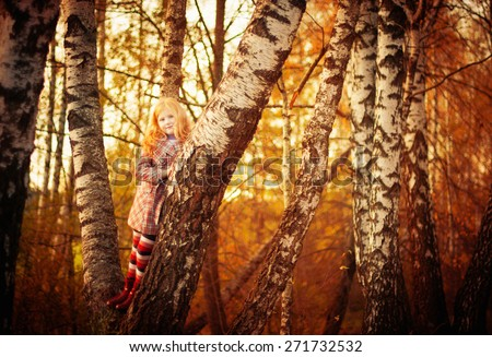 happy girl in autumn forest - stock photo
