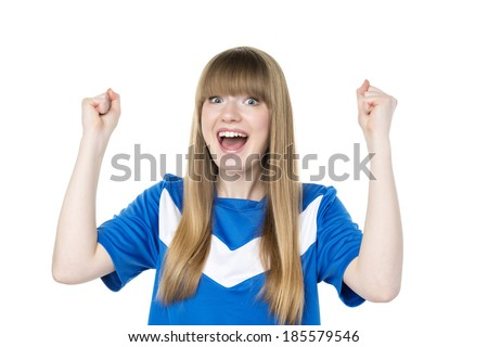 Happy girl in blue soccer shirt is holding her fists up