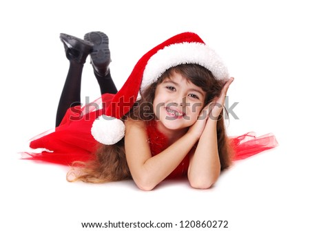 Happy girl in Christmas dress laying on the floor isolated on white