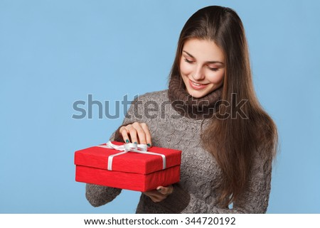 Happy girl in excitement opening Christmas box. Excited woman. Christmas Gift - stock photo