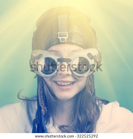 Happy girl in flying helmet