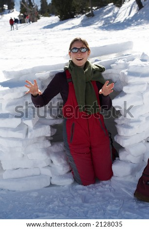 Happy girl  in front of an igloo