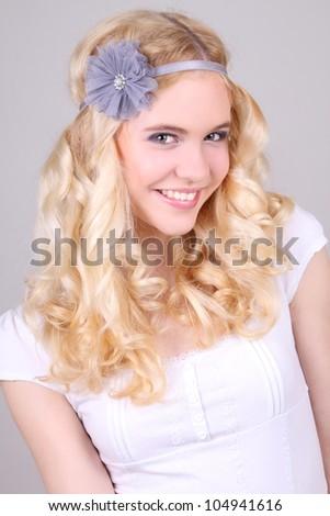 Happy girl in hippy style with grey headband - stock photo