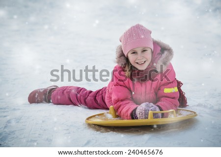 Happy girl in red clothes in winter outdoors - stock photo