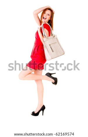 happy girl in red dress and in black shoes with bag smiling and enjoing life