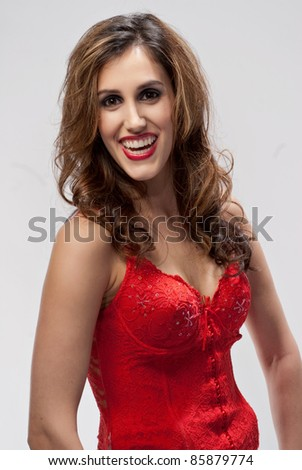 Happy girl in red shirt with a big laugh showing her teeth