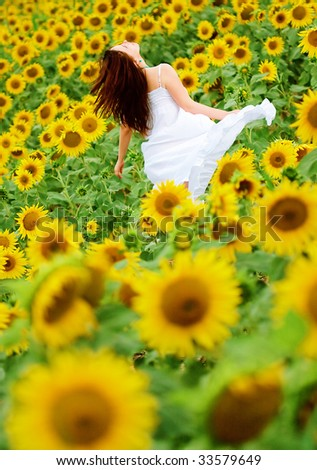 happy girl in the field of sunflowers - stock photo