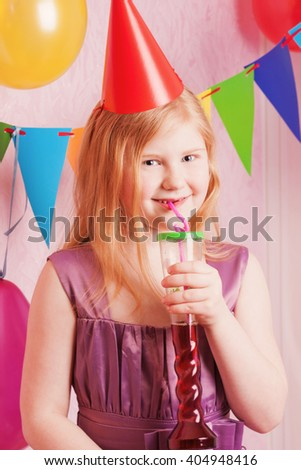 happy girl is drinking her strawberry juice - stock photo