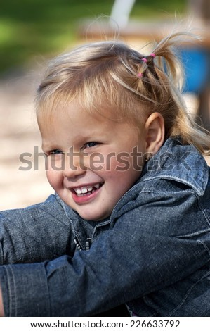 Happy girl is playing - stock photo