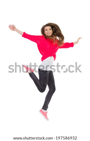 Happy girl jumping. Carefree young woman jumping with arms outstretched. Full length studio shot isolated on white. - stock photo