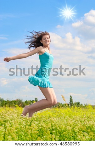Happy girl jumping in the sky and laughing. - stock photo