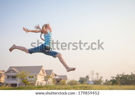 happy  girl jumping on the nature - stock photo