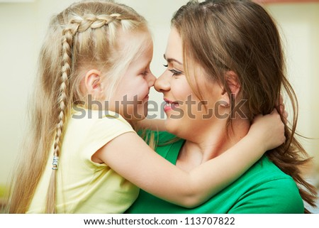 Happy Girl kid with mother. Indoor home close up portrait  portrait. - stock photo