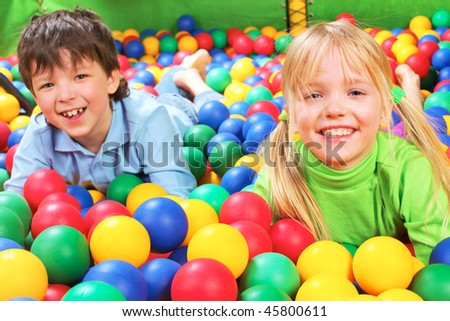 Happy girl laughing on background of her friend - stock photo