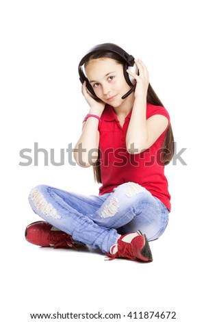 Happy Girl listening music isolated on white - stock photo