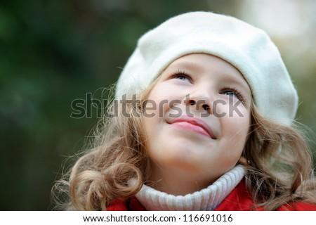Happy girl looking at the sky - stock photo