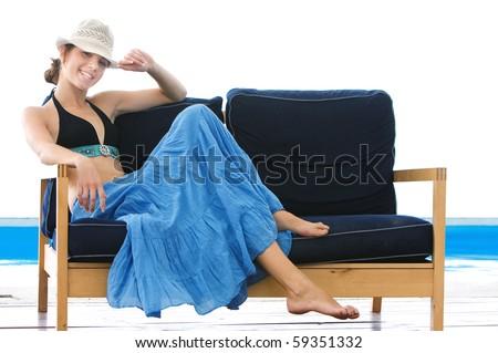 happy girl on beach sofa isolated over white - stock photo