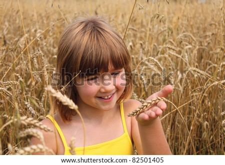 happy girl on field of wheat - stock photo