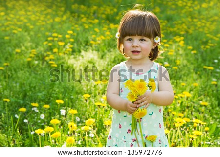 Happy girl on the meadow with white flowers - stock photo