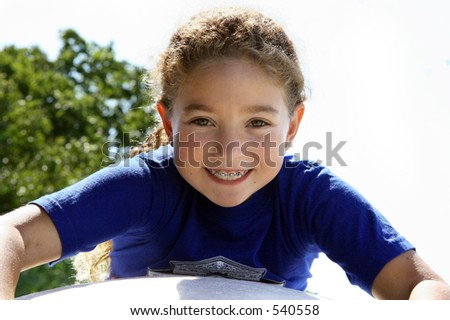 Happy girl outdoors - stock photo