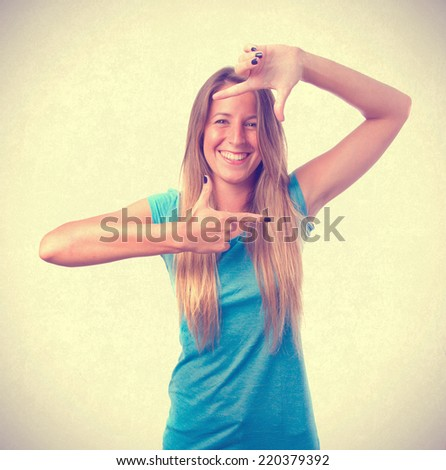 Happy girl photograph gesture - stock photo