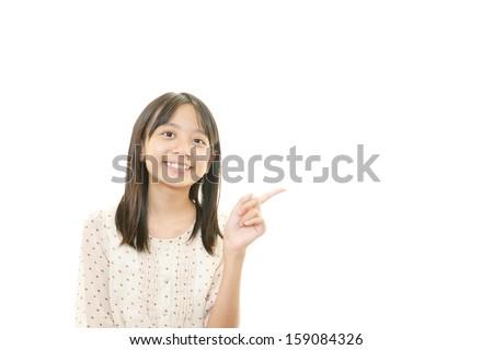 Happy girl pointing - stock photo