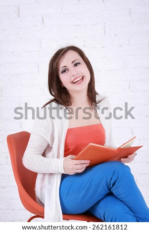 happy girl reading a book - stock photo