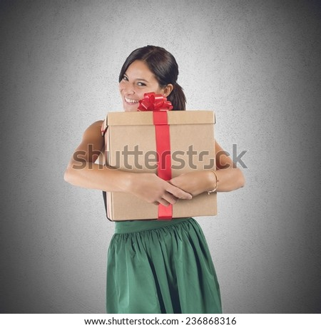 Happy girl receives and embraces a great gift - stock photo