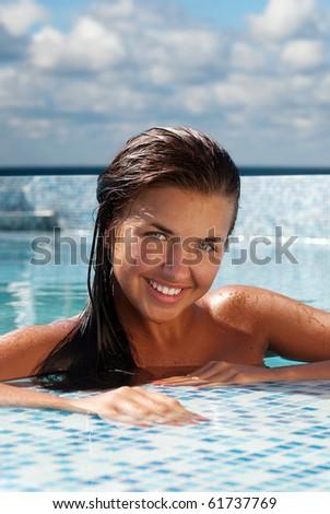 Happy girl relaxing in pool - stock photo