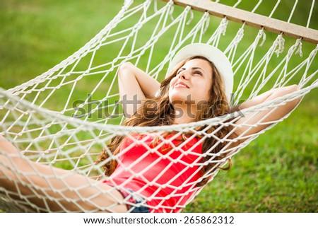 Happy girl resting in hammock - stock photo