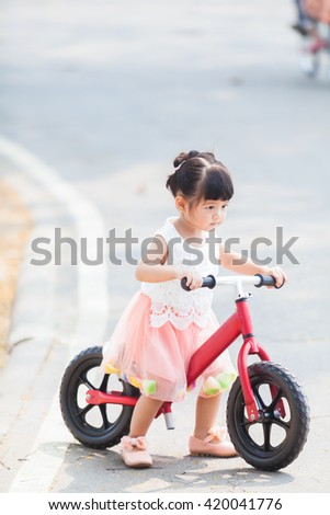 Happy Girl ride the Bicycle