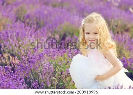 happy girl running in lavender field  - stock photo