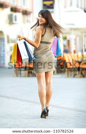 Happy girl shopping in the city