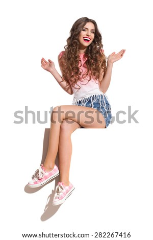Happy Girl Sitting On A Top Of Banner - stock photo