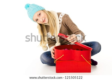 happy girl sitting on the floor with gifts - stock photo