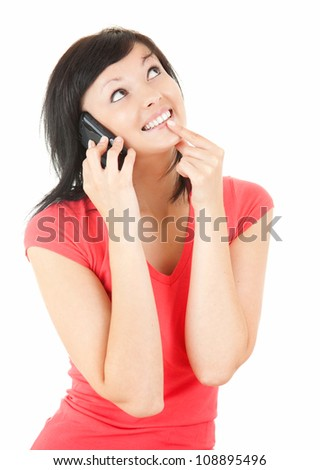 happy girl speaking on the phone and looking up; white background - stock photo