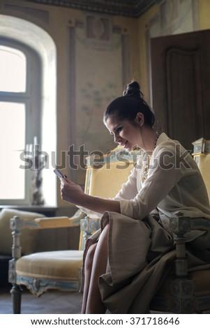 Happy girl texting - stock photo