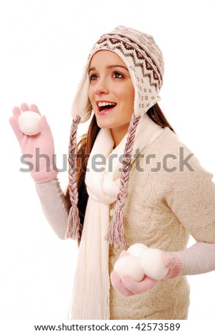 Happy girl throwing snowball on white background - stock photo