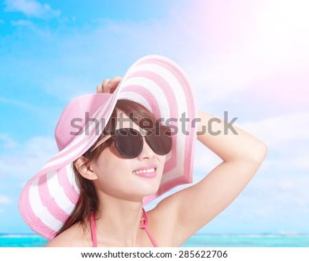 Happy girl wear bikini at sea beach and smile, asian beauty - stock photo