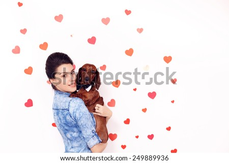 happy girl with a dog dachshund against the background of the heart. close-up Valentine's Day  - stock photo