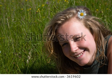 Happy girl with a flower in her hair